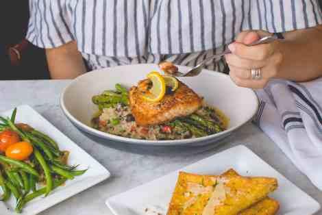 women eating salmon and quinoa