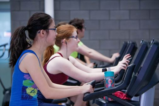 girls on a treadmill at the gym