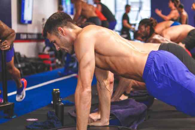 EBOOST event, guy doing push-ups
