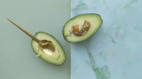 avocado cut in half, spooned out