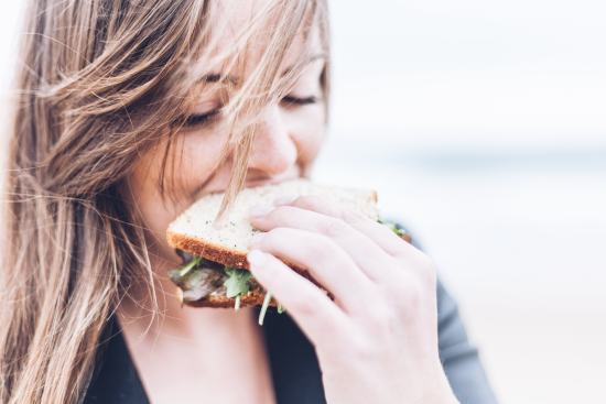women eating a veggie sandwich