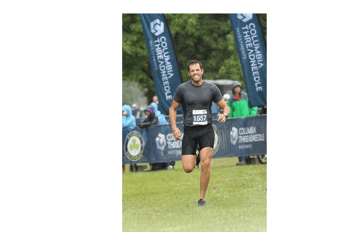 EBOOST Ambassador Sam Poryanda running in a race