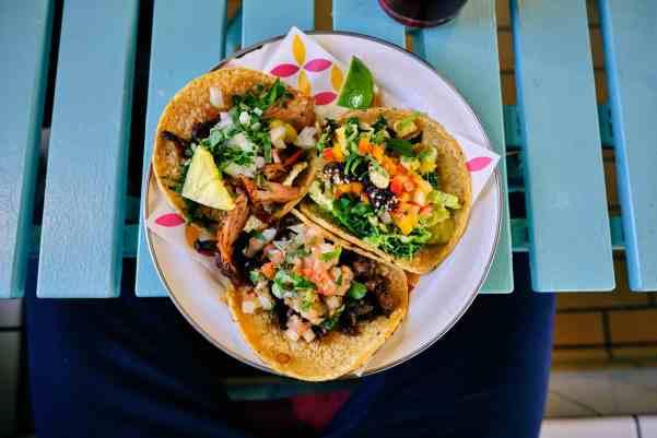 three corn tacos on a plate