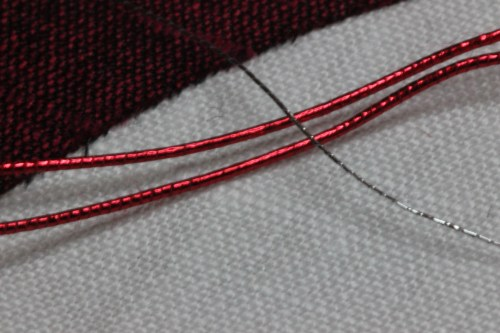 Red Smooth Passing with silver thread for outlining