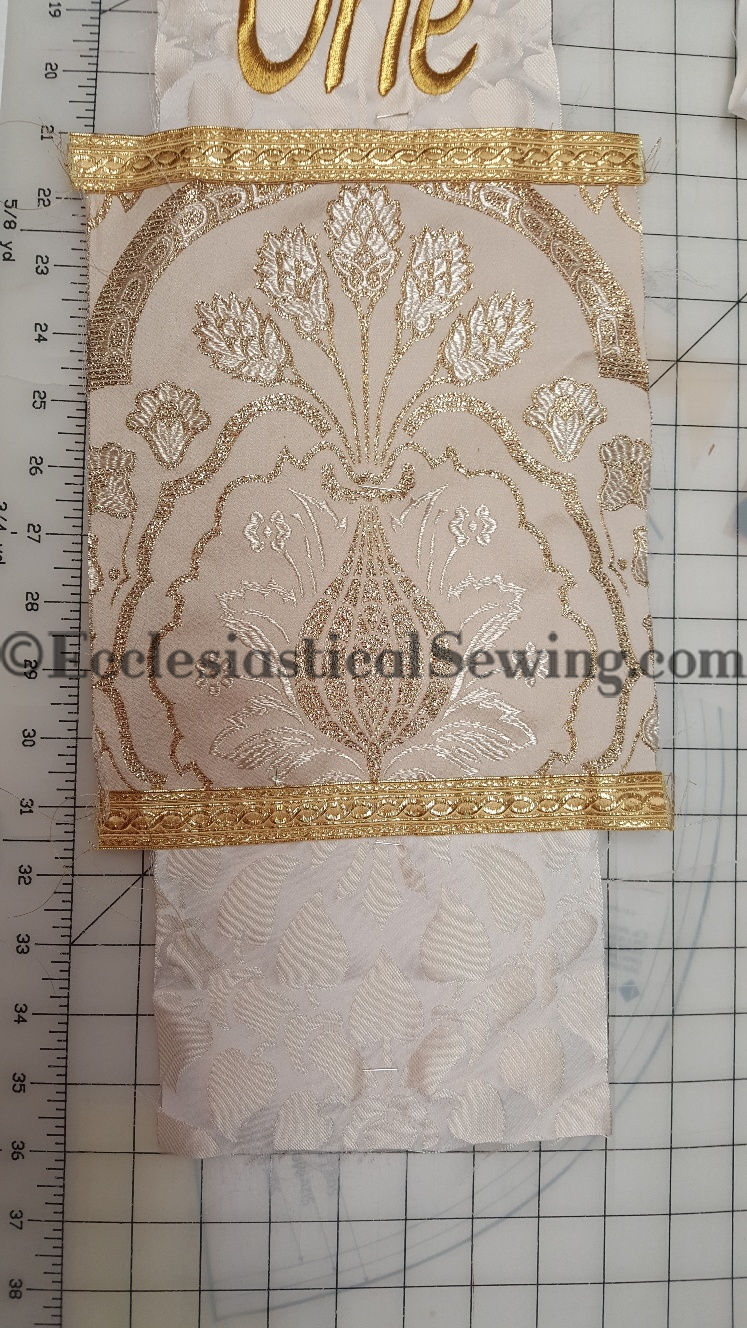 liturgical brocade, religious vestment fabric, stole fabric historical costume fabric, ivory brocade fabric, Ecclesiastical Sewing, Baxter, gold galloon trim, brocatelle, damask, priest vestment white stole for easter cream silk gold metallic brocade embroidery trim Christian catholic lutheran holiday scissor red cutting board grid table black stole blue iron on canvas how to sew