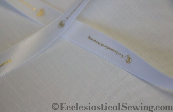 fabric samples for white linen altar church robe vestments from Ecclesiastical Sewing ribbon logo metallic gold custom
