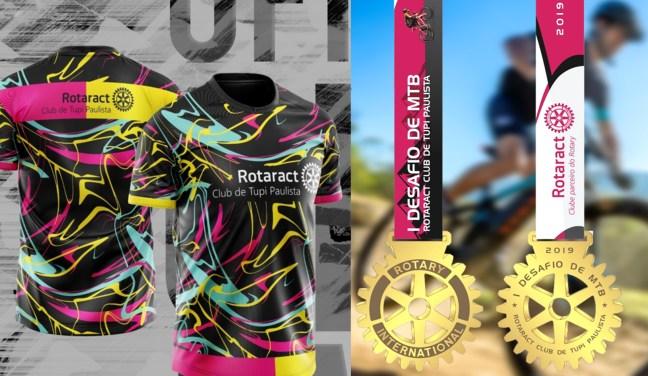 Foto mostra camisetas e medalhas da competição de MTB do Rotaract de Tupi Paulista