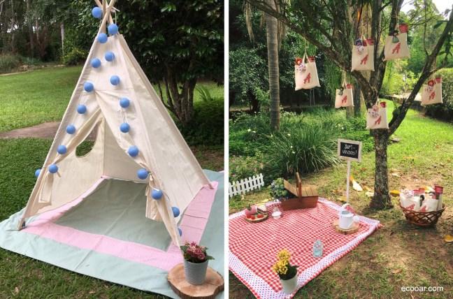 Foto contém uma cabana e uma árvore  com decoração infantil