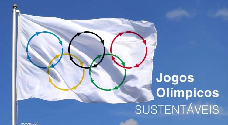 Foto mostra banderia branca e anéis simbolizando os Jogos Olímpicos Sustentáveis
