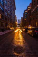 A view of the Manhattan bridge in Dumbo Brookly NYC on a cold sunset night