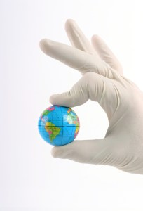 Photo: Hand holding a globe.
