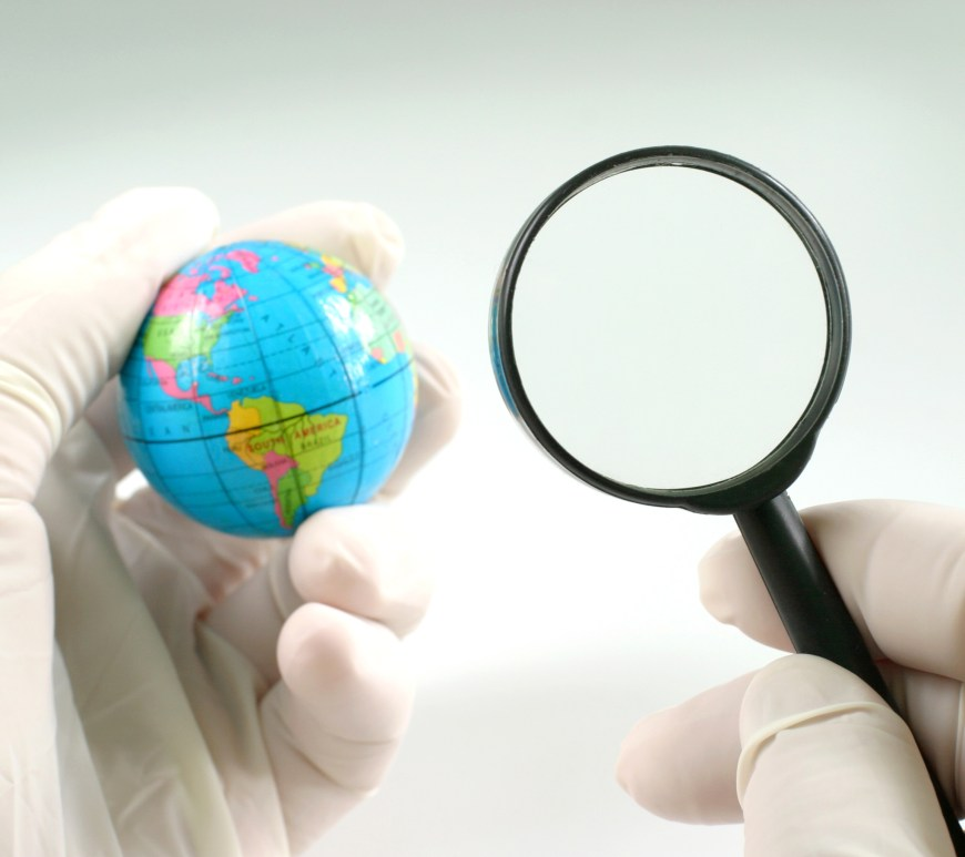 Photo: globe with a magnifying glass