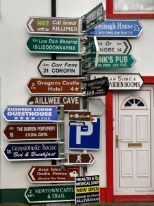 Signs in Ballyvaughan, County Clare, Ireland, point to many different places of interest.Photograph by Paolo Bernabei