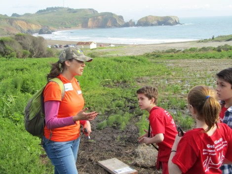 "Wildlife biologist Patricia Valarcel and some St. Ann Academy students search for snakes in the Marin Headlands at a ""Reptiles and Other Herps"" species inventory at BioBlitz 2014. ""Herp"" is short for herpetology—the study of reptiles and amphibians. Herp is much more fun to say than ""ectothermic tetrapods."" Photograph by Stuart Thornton, National Geographic"