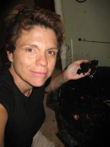 Anne holding composting worms. Photo by Anne Lewis.