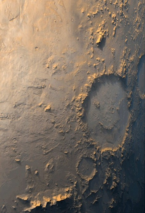This smiley face was the first image to greet the stellar cartographers of the Mars Orbiter Camera in 1999. Photograph by NASA/JPL/MSSS
