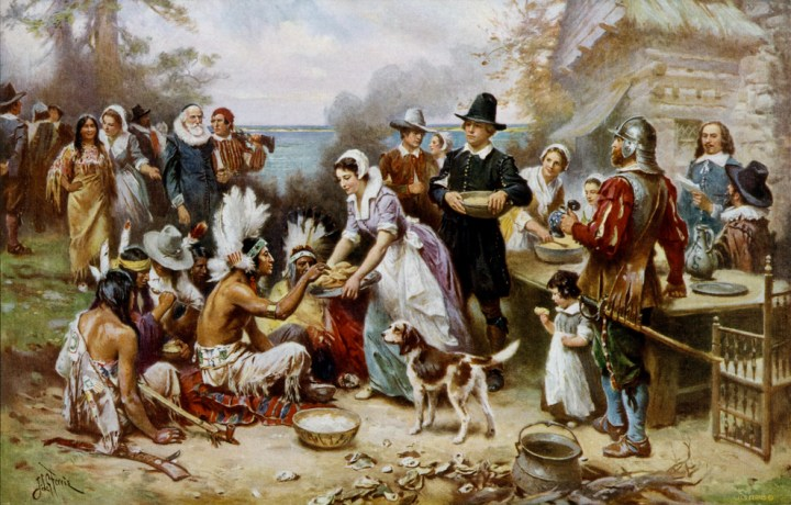 "This painting of the ""First Thanksgiving"" depicts a rich, peaceful meal shared by 17th-century Pilgrims and Native Americans. The first thanksgiving feasts in North America were actually celebrated by Spanish conquistadores more than 50 years earlier. Painting by Jean Leon Gerome Ferris, courtesy Library of Congress"
