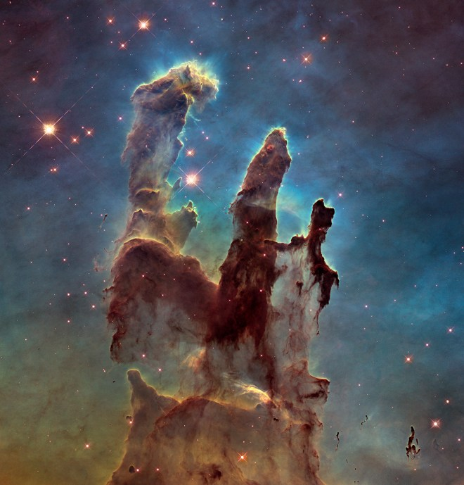"NASA's Hubble Space Telescope has revisited its famous 1995 photo of the ""Pillars of Creation,"" a stellar nursery in the Eagle Nebula. In the words of one of our favorite astronomers, ""Holy. Yikes. And this isn't even the high-res version; here's the 6,780 x 7,071 image if you want to choke down the 33 Mb file. And you do, because wow."" Photograph by NASA, ESA, and the Hubble Heritage Team (STScI/AURA)"