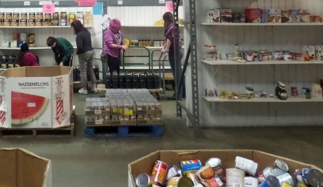 Photo of students in a food bank.