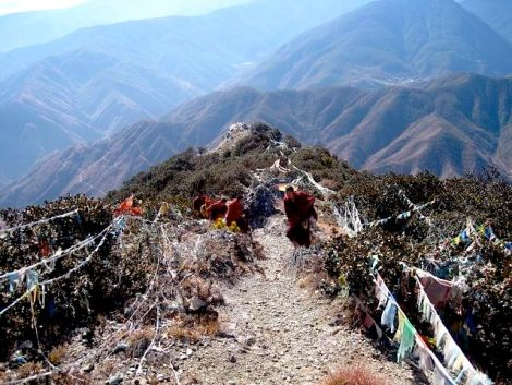 Thibet student monks removing illegal wildlife snares from a Mt. Rizhanigai Nature Reserve, considered a holy mountain.  Photo by QW Sun