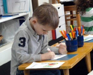 Photo of a boy drawing