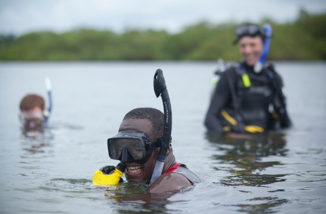 Dr. Karl Castillo laughs with coworkers during a dive.