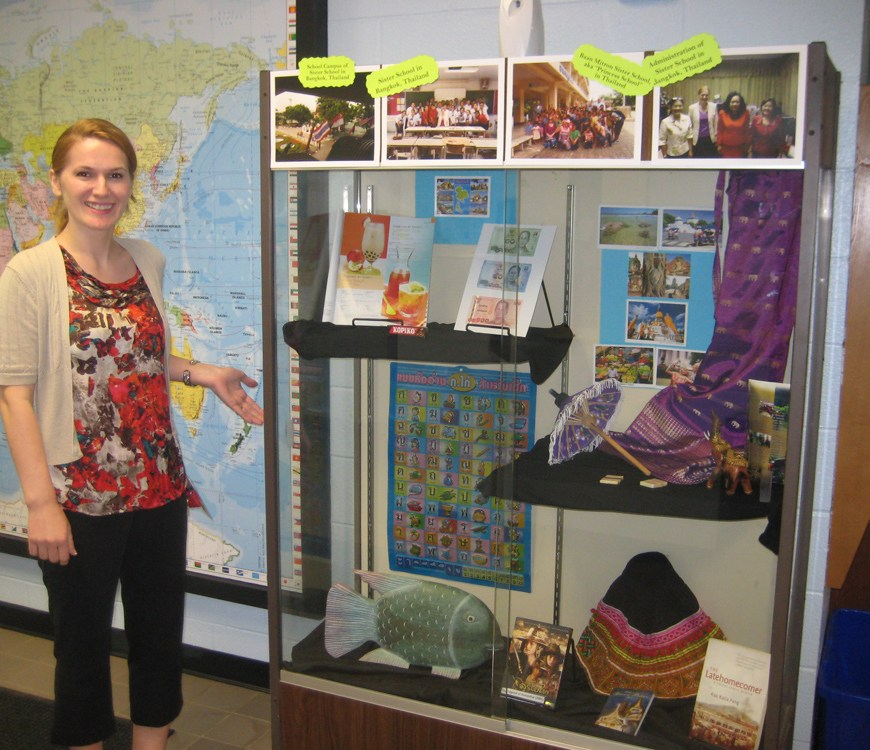 Mariana displays her students' work