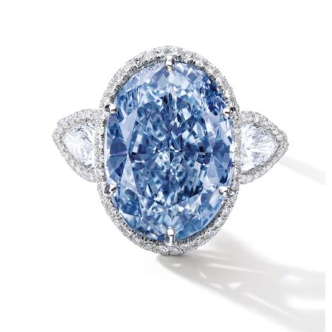 Behold the Millennium Jewel 4. This oval-cut, 10.10-carat blue beauty is flanked by two pear-shaped colorless diamonds and diamond band set in 18-karat white gold. Photograph by Sothebys