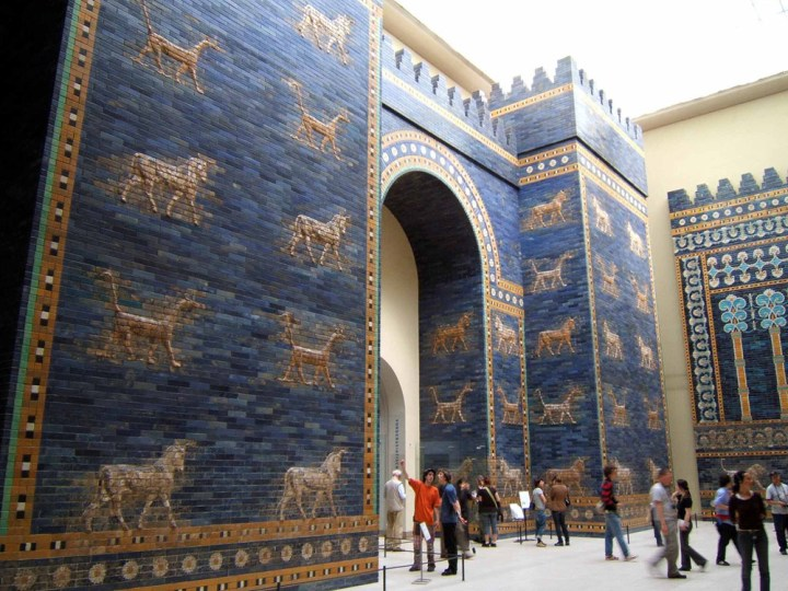 The roof and doors of the Ishtar Gate were made of cedar, and have long since deteriorated. Its clay bricks were glazed in lapis lazuli, a bright blue stone. Rows of dragons and aurochs, as well as flowers and geometric designs, decorate the gate. During King Nebuchadnezzar II's era, the Ishtar Gate was considered one of the Seven Wonders of the World. Today, artifacts are spread throughout museums of the world, with the largest portion in the Pergamon Museum in Berlin, Germany. Photograph by Rictor Norton, courtesy Wikimedia. CC-BY-2.0