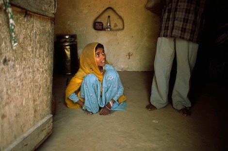 "Child brides like this girl in Rajasthan, India, ""cannot refuse or leave because of threats, violence, coercion, abuse of power or deception, with treatment akin to a farm animal,"" and so are considered slaves. Photograph by Jodi Cobb, National Geographic"