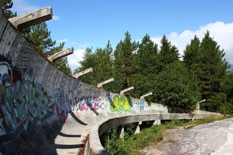 The Balkan forest and indigenous graffiti are reclaiming the bobsled track used in the 1984 Winter Olympics in Sarajevo, Bosnia and Herzegovina. Photograph by Julian Nitzsche, courtesy Wikimedia. CC-BY-SA-3.0