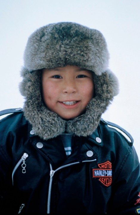 A young Inuit boy chills in Baffin Island, Canada. Photograph by Gordon Wiltsie, National Geographic