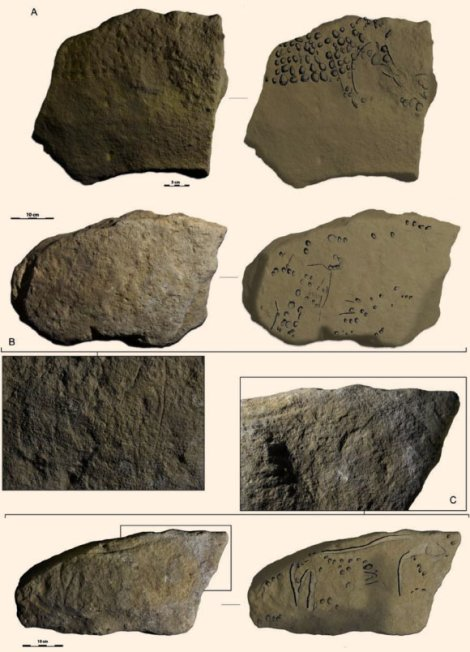 """These prehistoric blocks feature polka-dot representations of mammoths (A and B) and a horse (C). Other pre-""""Pointillist"""" blocks feature aurochs and rhinoceroses. Image courtesy Randall White et. al, http://dx.doi.org/10.1016/j.quaint.2017.02.001 """"Newly discovered Aurignacian engraved blocks from Abri Cellier: History, context and dating"""""""