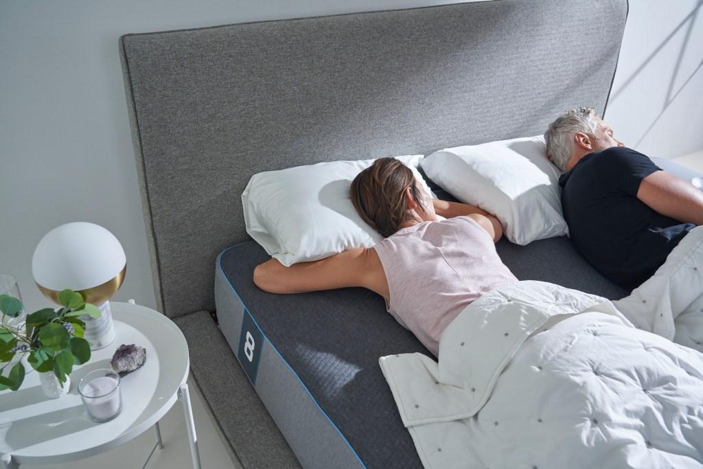 Couple sleeping on Eight Sleep Pod Pro