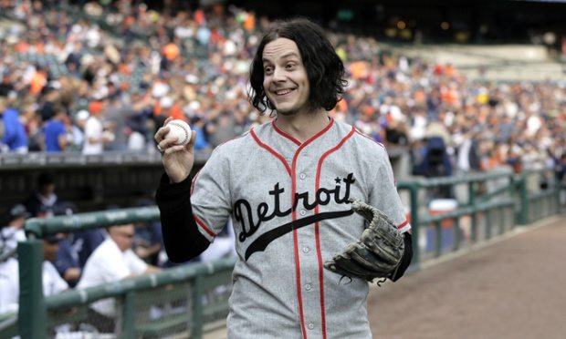 FILE - In this July 29, 2014 file photo, musician Jack White shows off a baseball before throwing out the ceremonial first pitch before the Detroit Tigers baseball game against the Chicago White Sox in Detroit. White is planning a return to his Detroit roots with a new Third Man Records store. White and Shinola, a business that makes watches and other goods in Detroit, announced Tuesday, June 2, 2015, they've partnered to buy the building housing Shinola. (AP Photo/Duane Burleson)