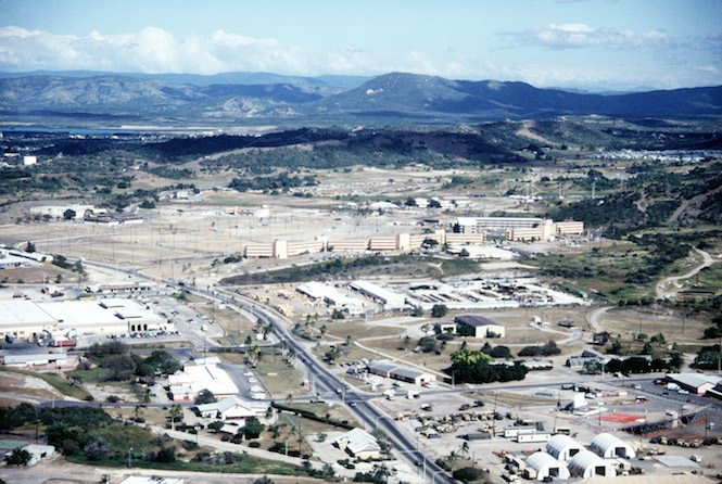 An aerial view of Naval Base Guantanamo Bay's windward side, looking northeast, showing the Navy Exchange and the Bachelor Enlisted Quarters (BEQ) area.