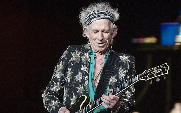 Keith Richards, of the Rolling Stones, performs at Comerica Park, Wednesday, July 8, 2015, in Detroit.  (Daniel Mears/Detroit News via AP)  DETROIT FREE PRESS OUT; HUFFINGTON POST OUT; MANDATORY CREDIT