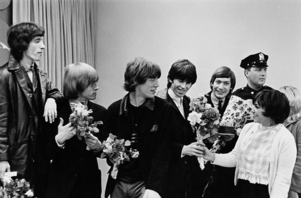The Rolling Stones receive bouquets in New York, June 1964. Left to right: Bill Wyman, Brian Jones (1942 - 1969), Mick Jagger, Keith Richards and Charlie Watts. (Photo by William Lovelace/Daily Express/Hulton Archive/Getty Images)