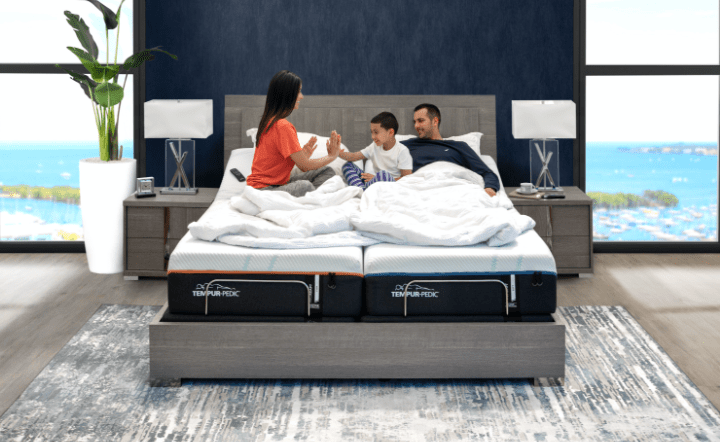 Man and woman and child sitting in bed in lifestyle setting by El Dorado Furniture