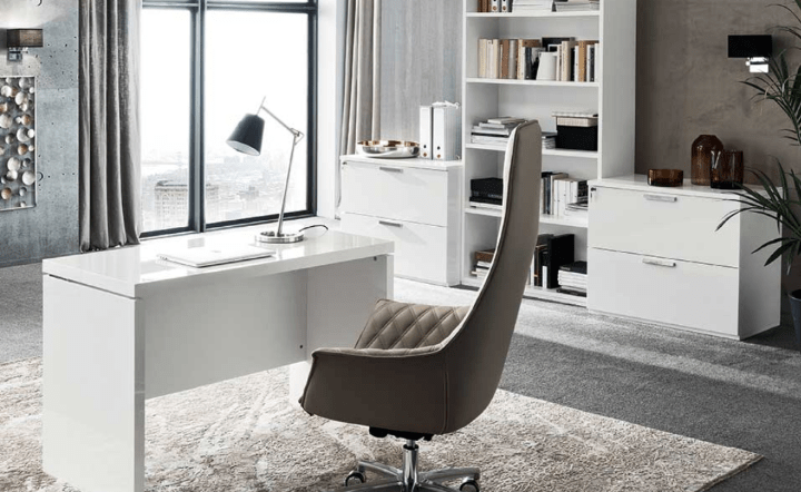 White desk, white cabinets, white bookcase, and cream desk chair in lifestyle setting