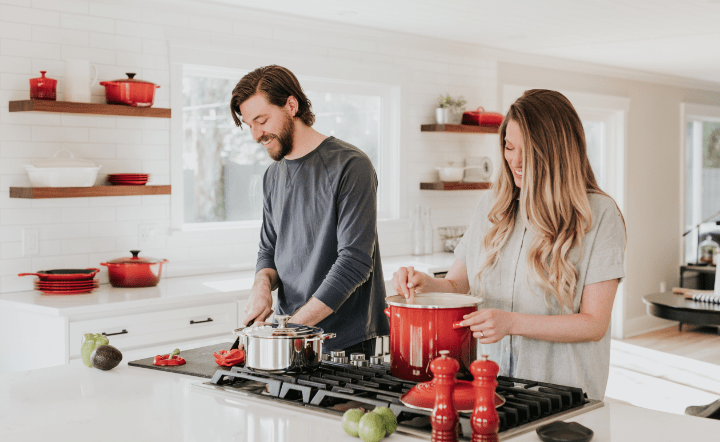 Man and woman in kitchen cooking