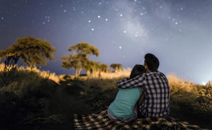 Man and woman stargazing