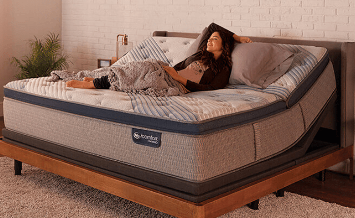 Woman lying in bed with adjustable base in lifestyle setting
