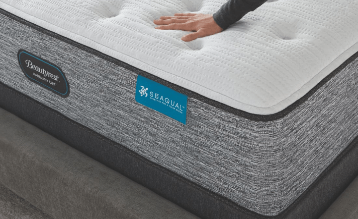 Close-up of foundation and mattress with woman's hand on mattress