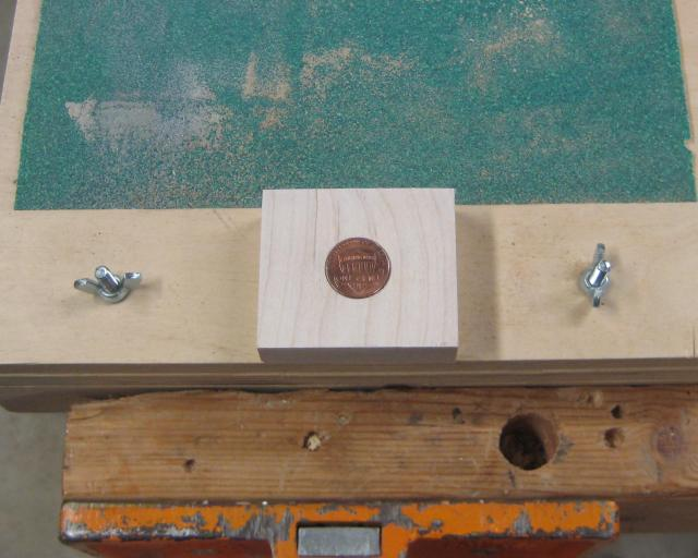 Penny holder for sanding copper off one side