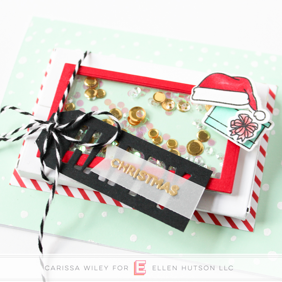 Close up of Christmas themed Essentials by Ellen Parcel Box shaker