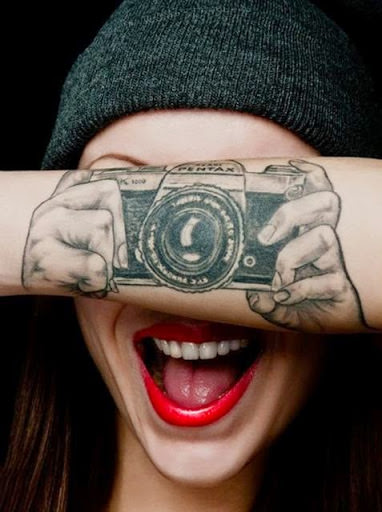 Amazing 3d tattoo on arm, it seems both hand holding the camera and ready for click.