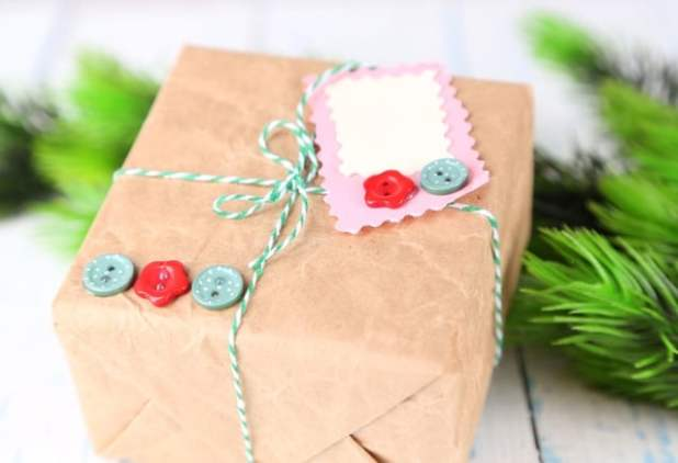 Paper gift box on wooden background