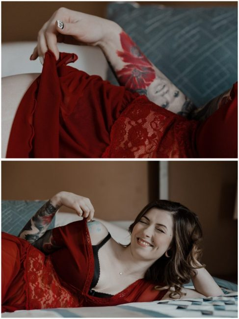 woman flirtatiously plays with her red lingerie dress during her regina boudoir photography session in regina