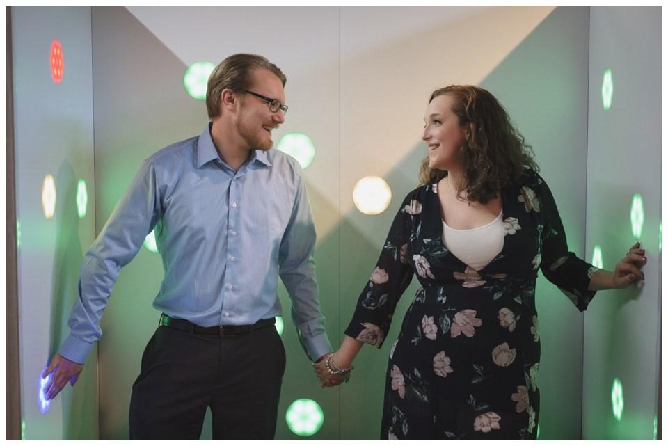 couple holding hands science centre engagement session regina